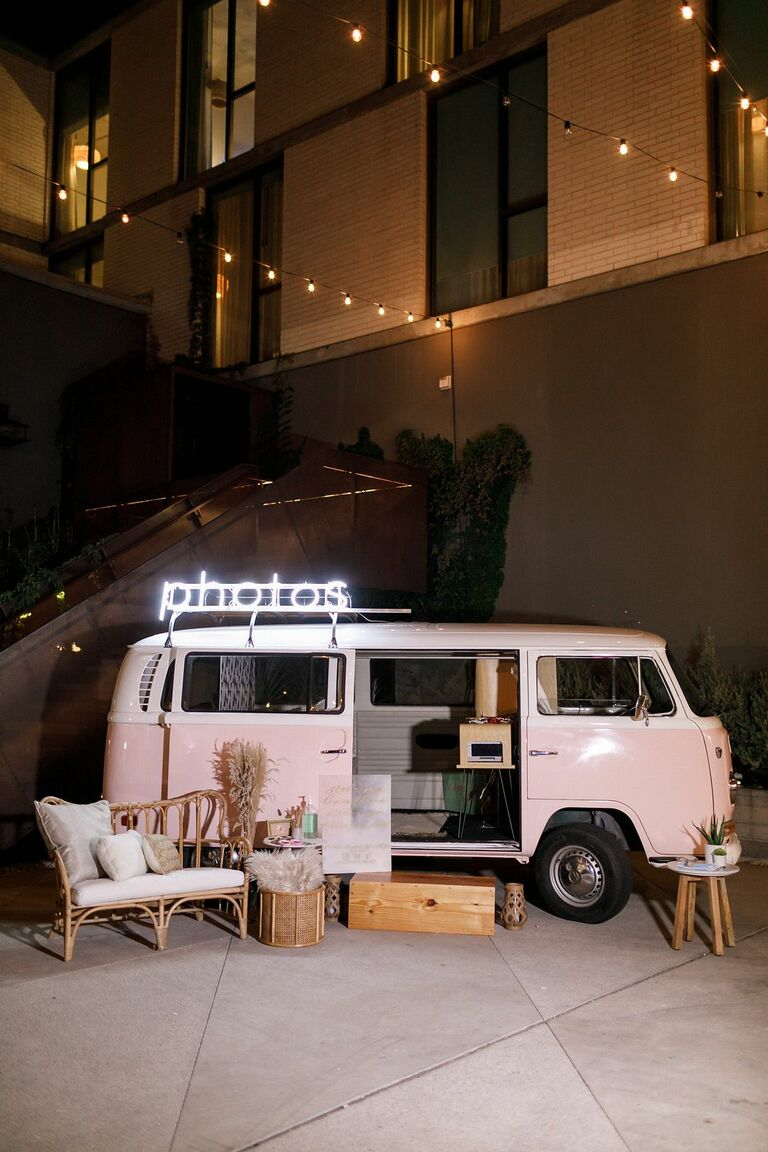 Pink VW bus photo booth with boho decorations