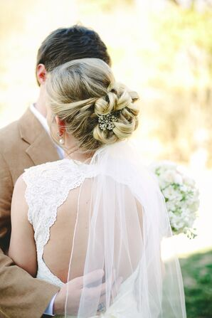 Elegant Wedding Updo with Embellished Hair Clip