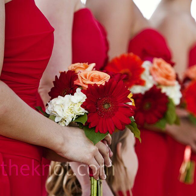 The bridesmaids carried a smaller version of the bride's bouquet, with fresh roses, dahlias, gerbera daisies, and hydrangeas.