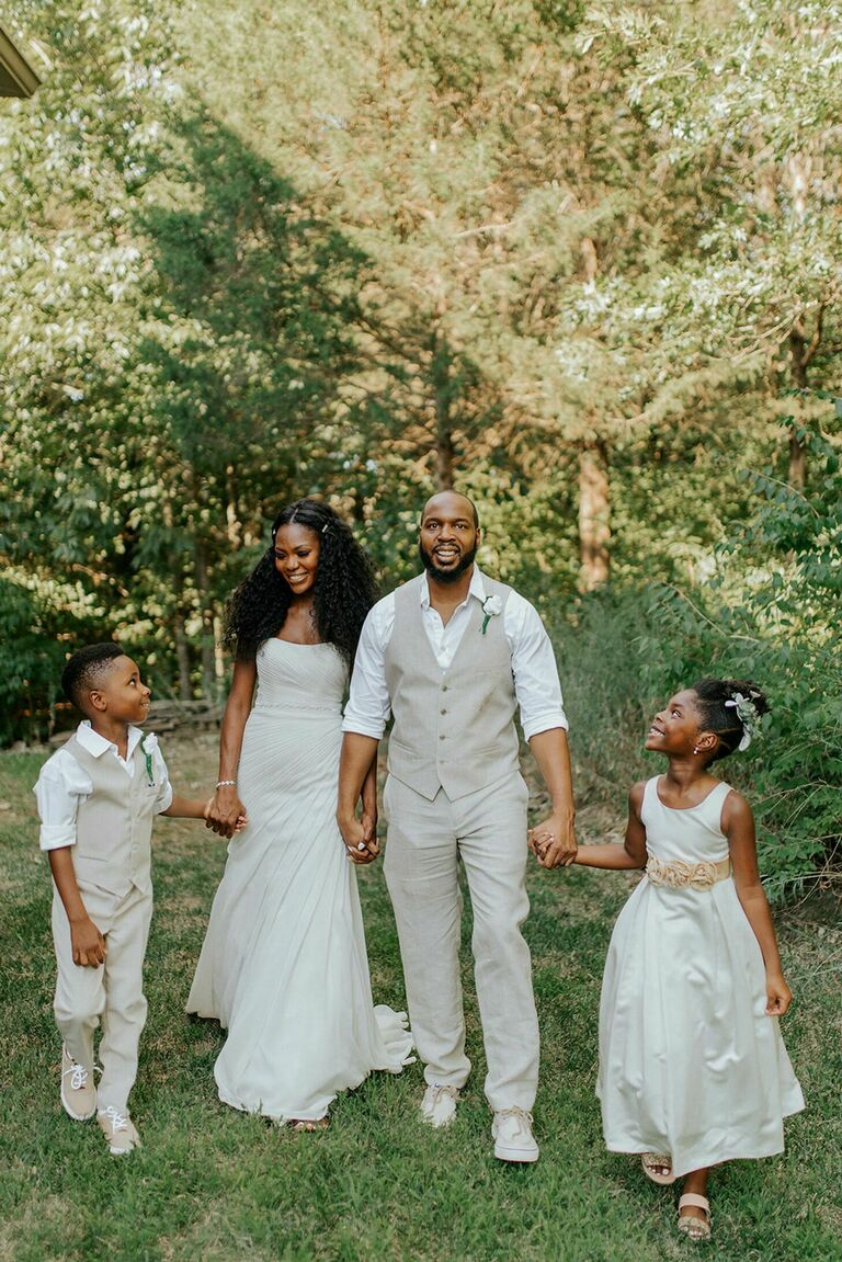 Family wearing casual white wedding attire