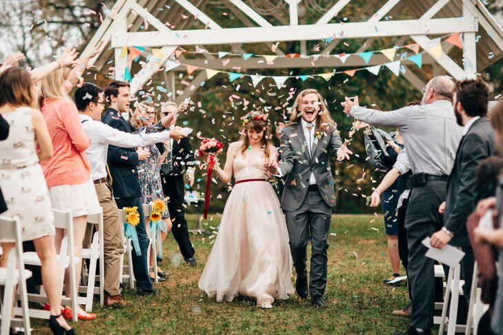 """After saying """"I do,"""" Jared and Bixby were showered with colorful confetti as they made their way up the aisle, tying into the celebration's confetti motif."""