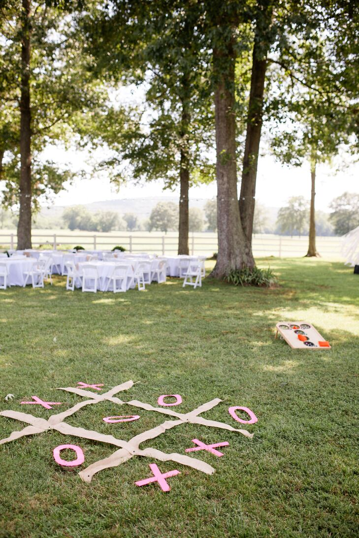 After exchanging vows, the newlyweds and their guests took the few steps over to the reception site to kick off the evening's festivities. After noshing on a delectable barbeque spread, complete with smoked chicken, mac n' cheese, baked beans and skillet corn, guests could enjoy try their hand at one of the several different lawn games the couple had set up on the lawn.