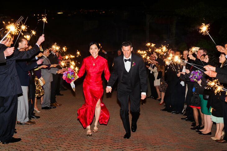 At the end of the celebration, the couple made their getaway through a tunnel of sparklers held aloft by their guests.