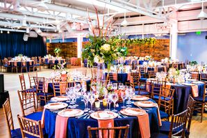 Navy Blue and Copper Tablescapes Topped with Tall Flower Arrangements