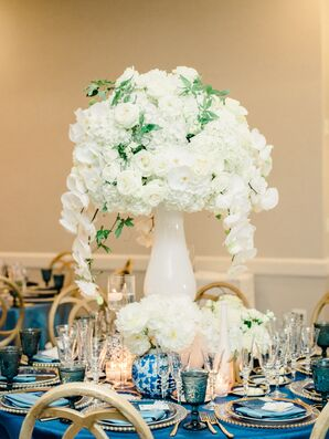 Cascading White Centerpieces of Orchids, Roses and Hydrangeas