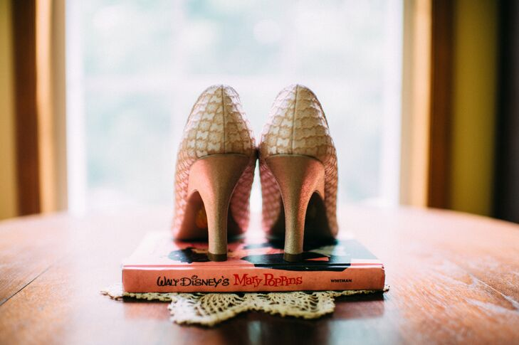 """For her wedding heels, Kim had specific requirements. """"I wanted vintage-looking shoes that were some form of pink or dusty rose and not too high,"""" she says. After searching through ModCloth, she found just that: Mary Jane heels with a neutral, antique-style patterns. Their double straps along the front and lower heels only added to the vintage look. (Since she loves Disney, it's """"Mary Poppins"""" stand was no surprise either.)"""