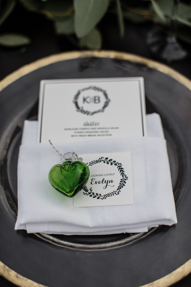 Green, glass-heart ornaments, each tied with the guest's name and a personal note or a joke, designated guests' places at the table and served as favors.