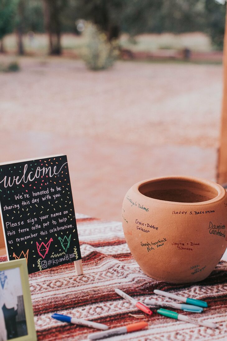 Instead of a guest book, attendees signed a clay pot with their names.