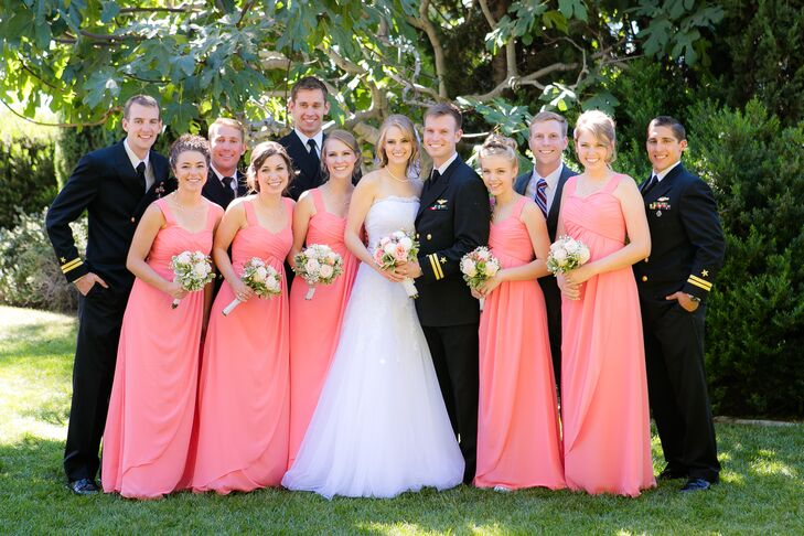 Micaela and Charles stood in the middle of their wedding party. The bridesmaids wore long coral dresses while most of the groomsmen wore their military uniform, besides Charles' older brother who wore a gray suit.