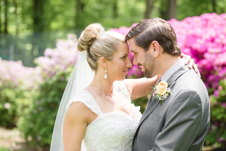 Keeping with the classic and elegant wedding style, Mandy's hairstylist, Megan Clifford, styled her hair into a clean bun with a small tiara accessory purchased from Eva's Bridal of Chicago, Illinois.