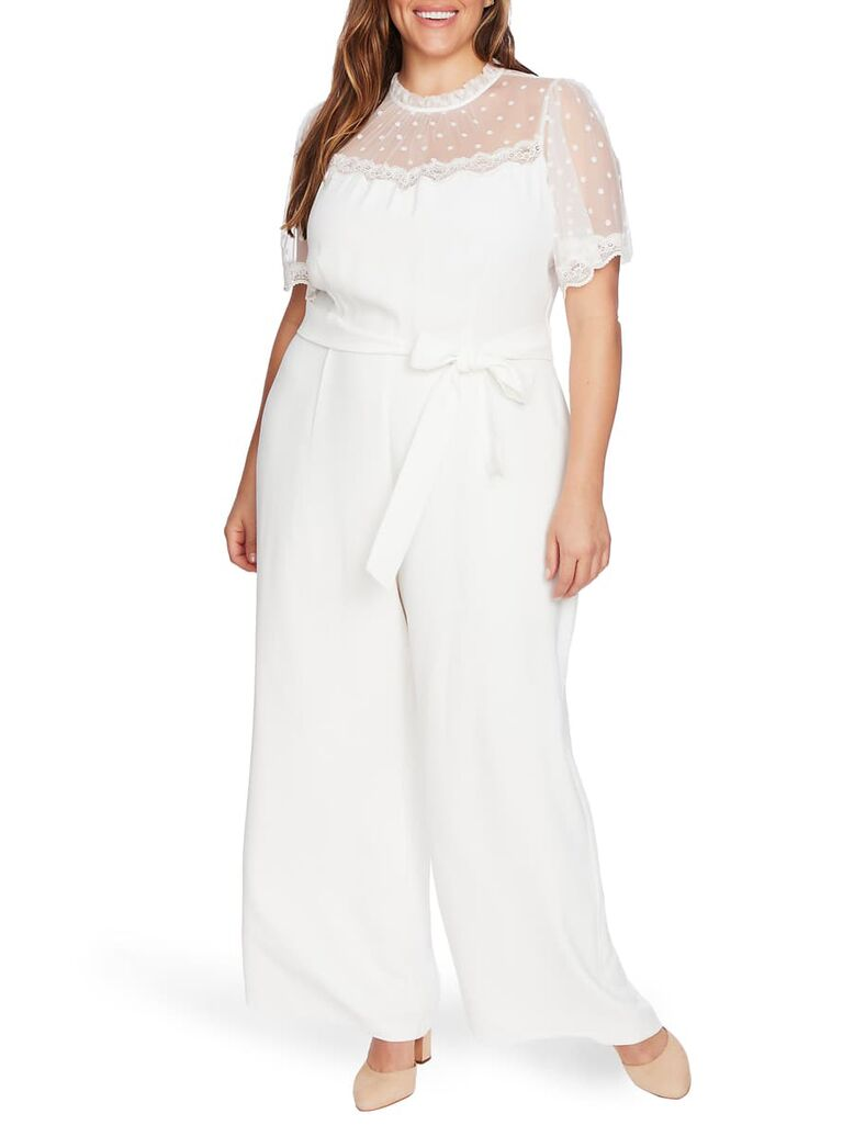 White belted jumpsuit with sheer mesh neckline