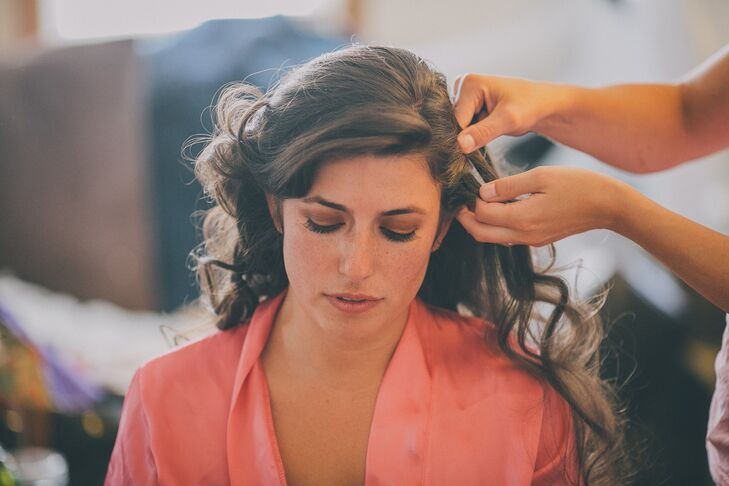 Bride Getting Ready in a Salmon Colored Satin Robe