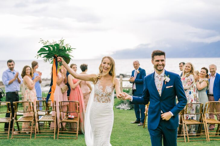 """The elegant, chic and romantic mermaid gown was designed by Ines Di Santo and was perfect for Hawaii,"" says Evgeniya. In a nod to the verdant setting, the groom donned a bright blue suit with a floral-print tie."