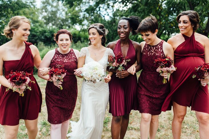 "Elizabeth let her bridesmaids pick any dress style they wanted, as long as it was short and in a burgundy or merlot color. ""I understand how expensive bridesmaid dresses can be, and I wanted to be respectful of each bridesmaid's budget,"" Elizabeth says. ""Plus, I wanted everyone to wear something they felt good in."" The girls completed their ensembles with nude shoes and understated drop earrings."