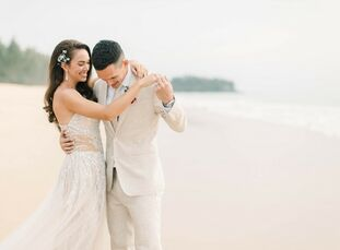 "Actress Taya Rogers and professional soccer player Mika Chunuonsee wed in a tropical, romantic wedding at Baba Beach Resort. ""We both always knew we w"
