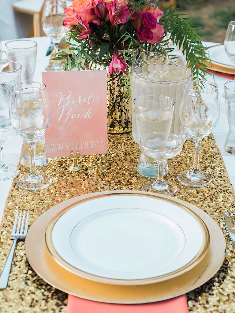 Glamorous gold place setting at a wedding reception