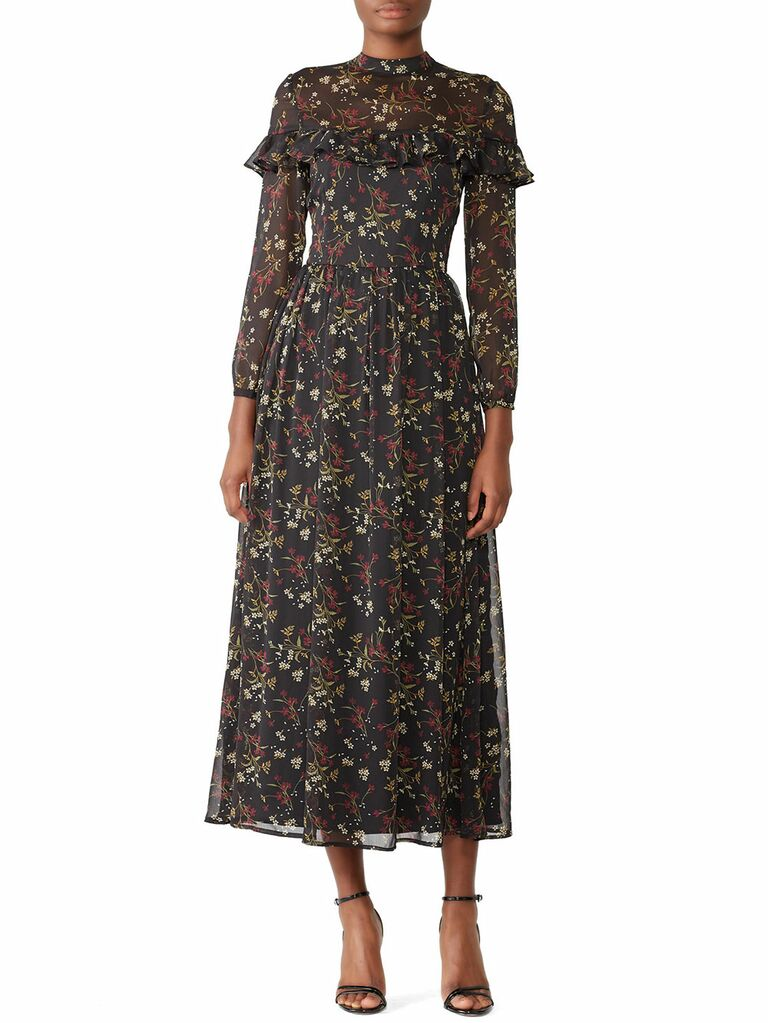 Black floral cottagecore dress with sheer neckline and long sleeves