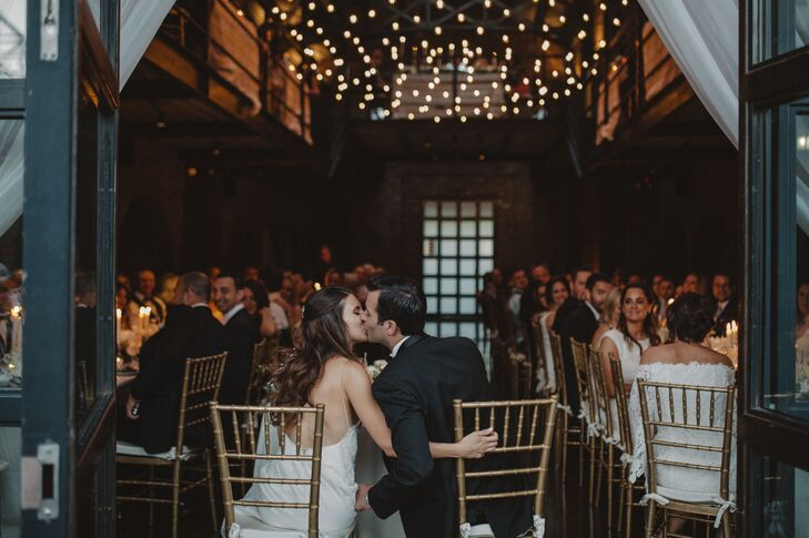 At the reception, which took place in main room at the Foundry in Long Island City, New York, an exposed-bulb chandelier added rustic ambiance.