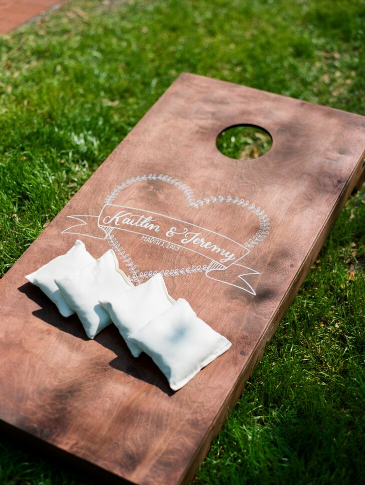 Lawn games added a fun element to the reception at Cross Creek Ranch in Dover, Florida, including cornhole with custom boards and beanbags and horseshoes in the wedding colors.