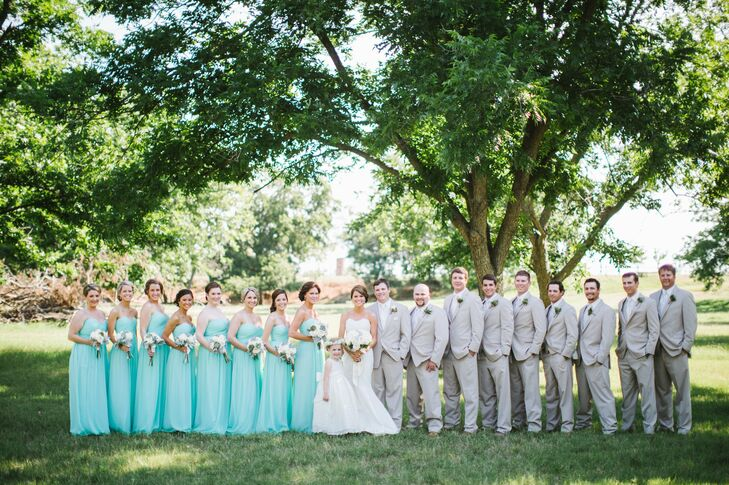 The wedding party dresses in light-colored attire for the outdoor celebration, a must in the Texas heat. The ladies wore mint-green chiffon dresses while the men wore tan linen, slim-fit suits.