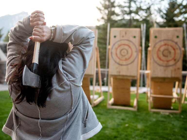 axe-throwing station at outdoor rustic party