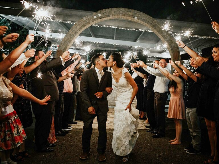 Newlyweds leaving reception with sparkler exit