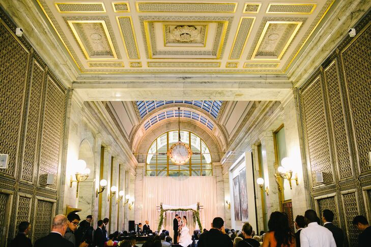 Jenny and Jamien were married underneath a traditional chuppah inside the Merchants Exchange Building in San Francisco, California. The historic room had intricate ceiling patterns and gold walls that needed little extra decor.