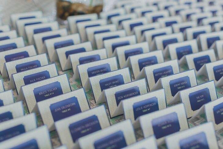 Blue escort cards followed the same theme as the couple's custom stationery.