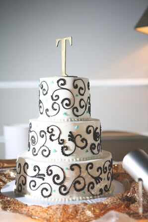 White Three-Tiered Wedding Cake with Black Scroll Details