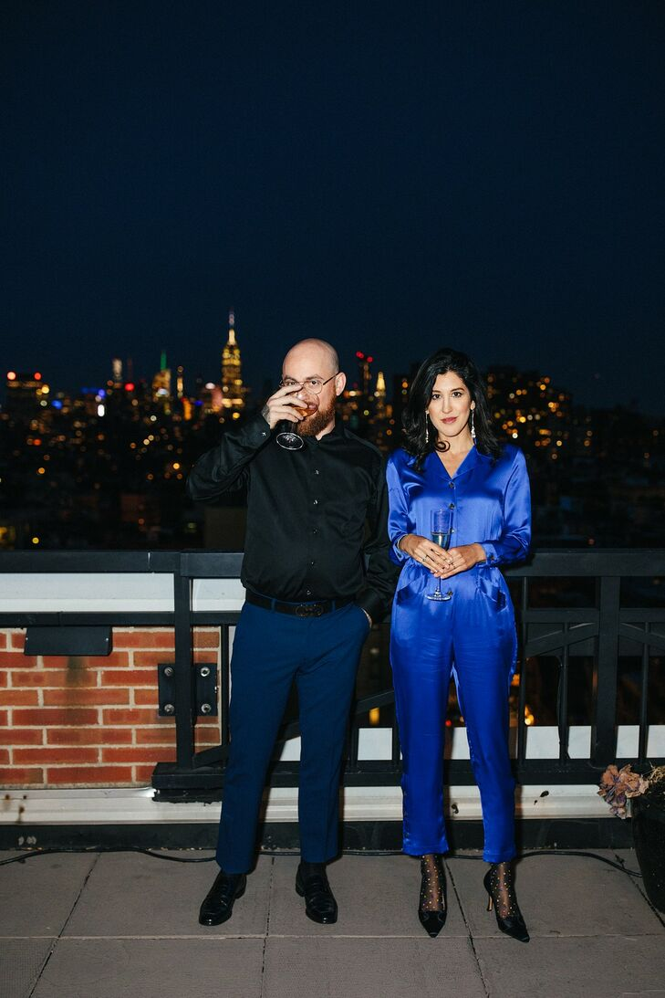 Modern Rooftop Reception with Blue Jumpsuit and Dress Shirt