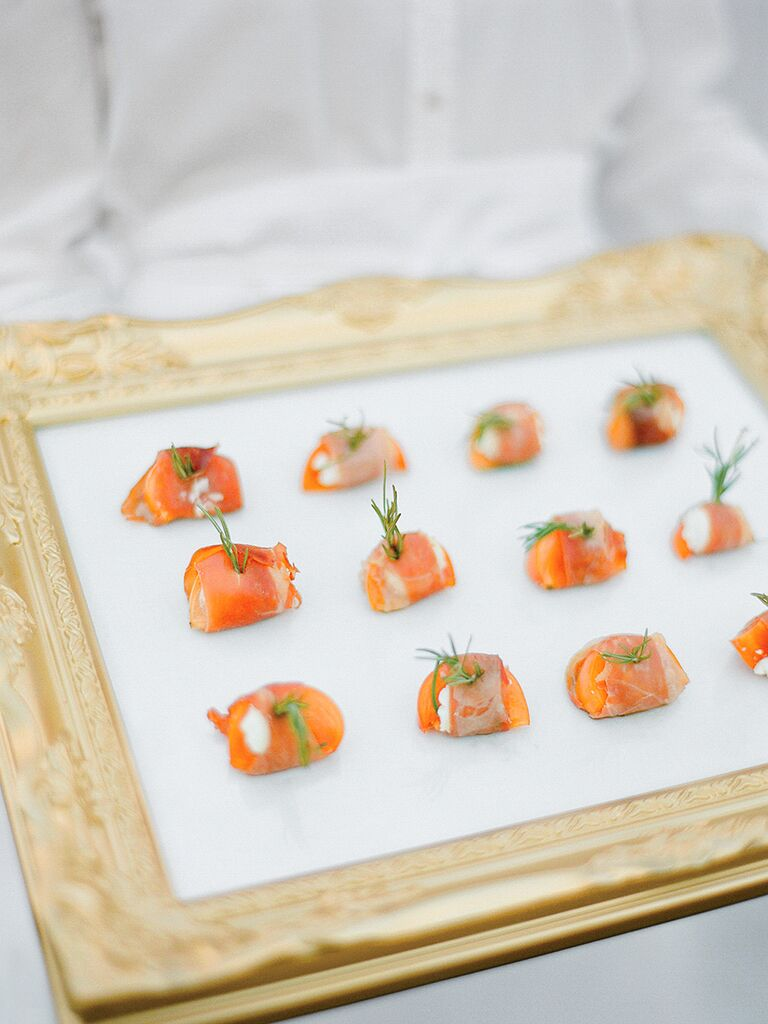 Prosciutto wrapped persimmons with goat cheese wedding reception appetizer