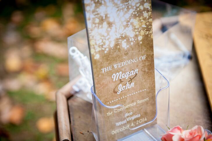The rustic ceremony programs were printed on kraft paper with white script for a natural look.