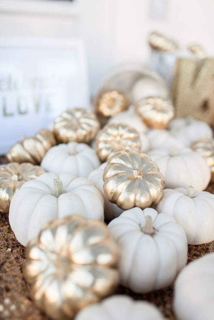 Since the wedding was held in October, Kendal wanted to incorporate some fall themed decor. She had about 60 miniature pumpkins which she painted shiny gold and used those on the welcome table, guest book table and bar. It was a great way to tie the season into the color palette.