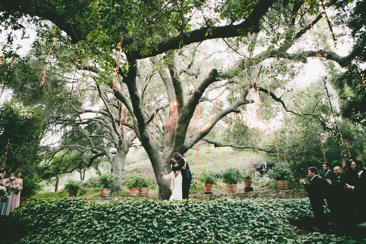 Marisa and Kyle got married outside Calamigos Ranch in Malibu, California, where they stood under a grand 100-year-old oak tree. An elevated platform with the front covered in green ivy allowed all friends and family to have a great view of the ceremony, no matter where they sat.
