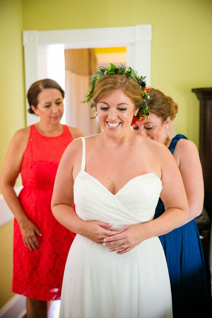 Since Chelsey and Matt got married outside in July in South Carolina, Chelsey wanted a light, breezy dress. She found a stunning white chiffon Theia Couture gown at Bleu Belle Bridal. She loved the light fabric and Grecian vibe with its halter neckline.