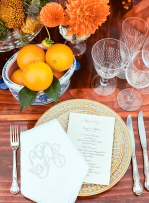 Placesetting with Monogram Napkin and Fresh Oranges