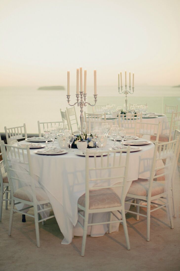Candlesticks surrounded by blue and white flowers adorned the reception tables for the guests.