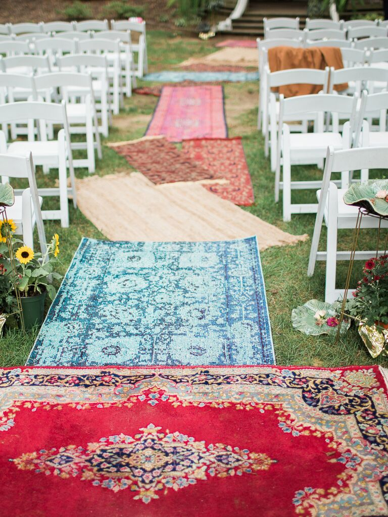 Vintage outdoor ceremony runner and altar idea with mismatched rugs