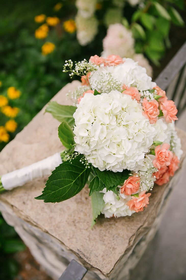 Kendal ordered white hydrangeas, peach carnations and baby's breath online and made all the bouquets, corsages and centerpieces the morning of the wedding.