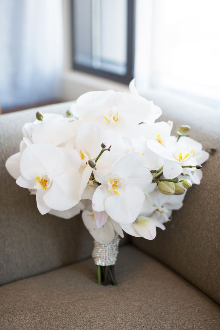 Courtney wanted all the flowers that decorated the day to be white, including her bridal bouquet filled solely with white orchids.