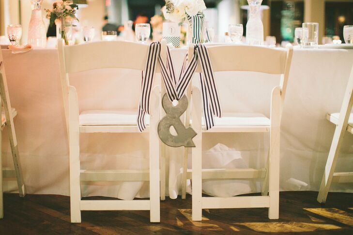 An ampersand, hung with a striped ribbon, connected the chairs where Emily and Preston sat during the reception.