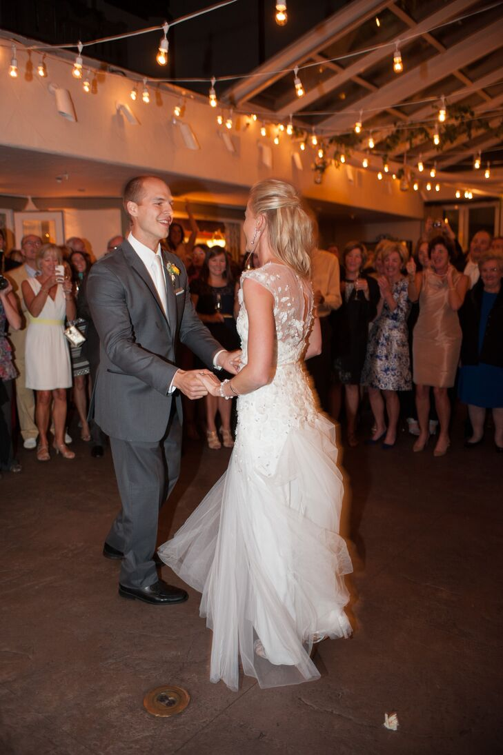 "Liz and Matt danced to ""Ain't No Mountain High Enough"" for their first dance."