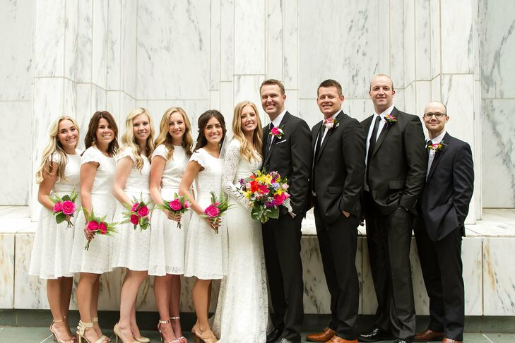 Bridesmaids wore ivory knee-length dresses with cap sleeves that matched Emily's look perfectly, while the groomsmen did the same with Preston and wore black suits with black ties.