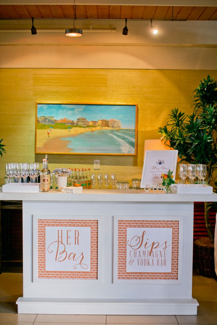 """Amanda and Alex created """"his"""" and """"hers"""" bars where they served speciality cocktails—bourbon for the groom and champagne and vodka for the bride."""