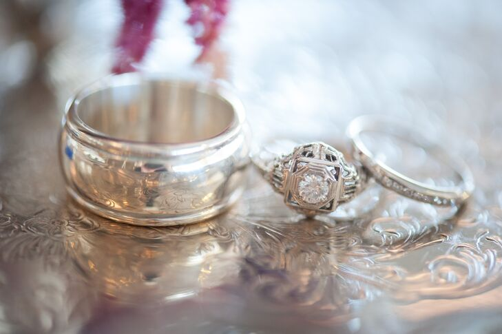 Jessi is an antique collector, so Rey chose a Victorian estate ring from Brilliant Earth to fit her tastes. The couple found a matching wedding ring in a local estate jewelry store, and found Rey's wedding ring in an antique shop.