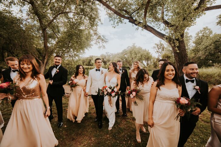 Elegant Wedding Party Wearing Cream Gowns and Black Suits