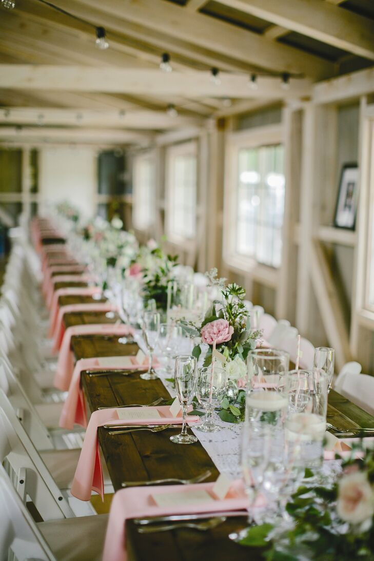 We wanted guests at our reception to feel like they were at a big family dinner with close friends and family. We chose to place the wooden farm tables together in a long row, Kayla says.