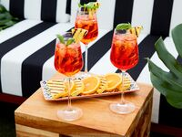 1. Aperol Spritz Garnished With Basil and Grilled Pineapple