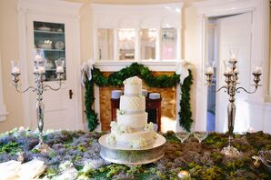 Whimsical Mossy Cake Display with Candelabras