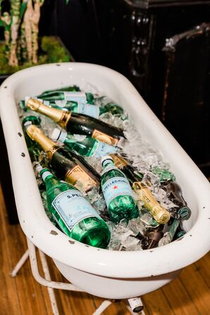 Tub with Champagne and Sparkling Water Bottles